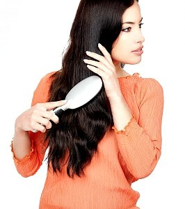 Woman Combing Her Hair by marin and freedigitalphotos