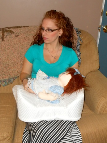 mom with nursing pillow