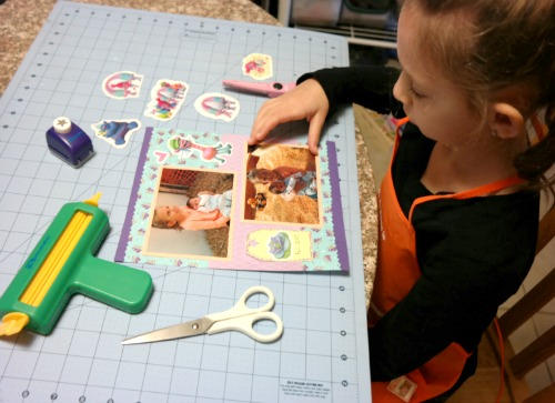 Princess G working on her scrapbook pages